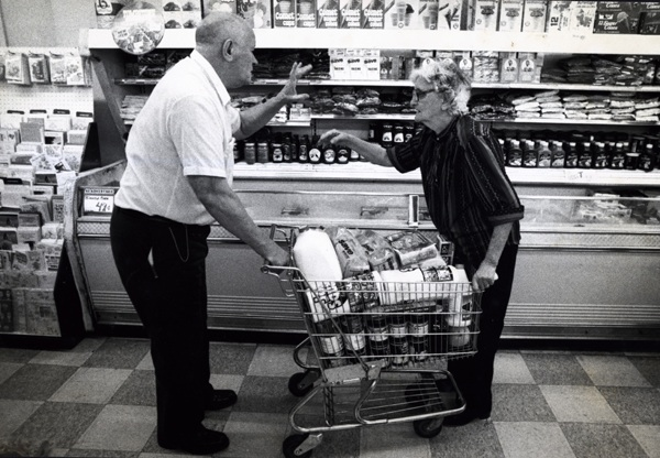 Grocery shopping can include some very animated discussions. (Copyright by John S. Stewart/LEFTeyeSTORIES.com)